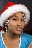 Cute african american girl. With a santa hat on and beads in her hair Royalty Free Stock Photos