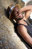 Cute african american guy smiling outdoors with hat Stock Photo