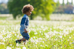 Cute african american little boy playing outdoor Stock Images