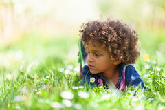Cute african american little boy playing outdoor Stock Photos