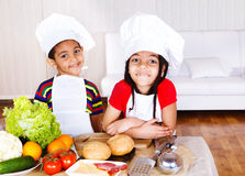 Cute african american little cooks Royalty Free Stock Images