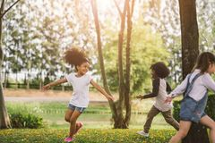 Cute african american little girl playing outdoor. Black people kid and friend happy royalty free stock photos