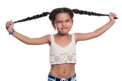 Cute african american small girl with a funny angry face pulling. Her hair isolated on a white background Stock Photography