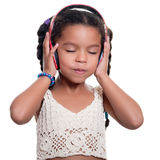 Cute african american small girl listening to music on wireless Stock Image