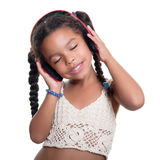 Cute african american small girl listening to music on wireless Stock Photo