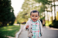Cute african american toddler having fun outdoors. In park Royalty Free Stock Photography