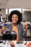 Cute african american woman with curly hair making photo for fashion magazine stock photos