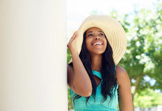 Cute african american woman smiling with sun hat Royalty Free Stock Photos
