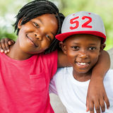 Cute african boy and girl outdoors. Close up face shot of smiling African boy and girl outdoors Royalty Free Stock Image