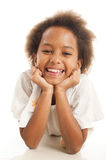 Cute African girl. A gorgeous little 7yr old African girl in the studio.  White background Stock Photos