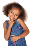 Cute african girl. Adorable cute african child with afro hair wearing a denim dress. The girl is standing and smiling at the camera Stock Photos