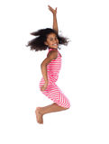Cute african girl. Adorable cute african child with afro hair wearing a white and pink striped dress. The girl is jumping and smiling Stock Images