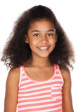 Cute african girl. Adorable cute african child with afro hair wearing a white and pink striped dress. The girl is standing and smiling at the camera Royalty Free Stock Photo