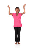 Cute african girl. Adorable small african child with braids wearing a bright green shirt and black skinny jeans. The girl is worshipping with her hands lifted up Stock Photography