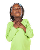 Cute african girl. Adorable small african child with braids wearing a bright green shirt. The girl is praying with her hands on her heart Stock Images