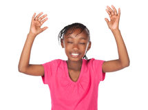 Cute african girl. Adorable small african child with braids wearing a bright pink shirt. The girl is worshipping with her hands lifted up Stock Image