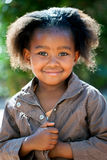 Cute african girl in brown jacket. Outdoor portrait of cute African girl wearing brown jacket Stock Photo