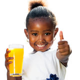 Cute african girl doing thumbs up holding orange juice Stock Image