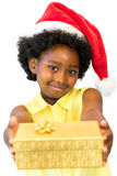 Cute african girl giving present. royalty free stock photos
