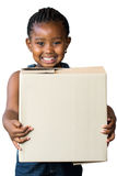 Cute african girl holding big cardboard box. Close up portrait of cute little african girl with braided hairstyle holding big cardboard box.Isolated on white Stock Photography