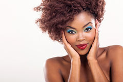 Cute african girl. With nice makeup on plain background Stock Photos