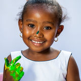 Cute african girl with painted hand. Stock Photo