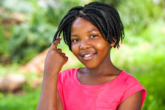Cute African girl showing braided hair. Close up portrait of Cute African girl showing braided hair outdoors in park Royalty Free Stock Image