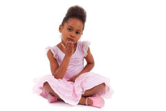 Cute African girl sitting on the floor Royalty Free Stock Photo