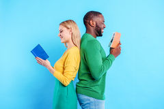 Cute african man and caucasian woman entertaining together Royalty Free Stock Photo