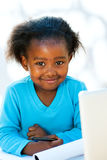 Cute african student doing homework. Royalty Free Stock Image
