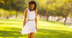 Cute African woman dancing in a park Royalty Free Stock Photography