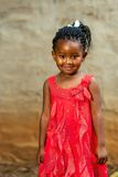 Cute african youngster in red dress. Royalty Free Stock Photography