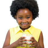Cute afro american kid holding glass with milk. Royalty Free Stock Photos