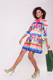 Cute afro american young woman with a shooping bag in hand royalty free stock photography