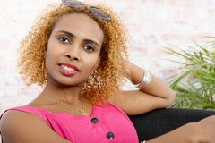 Cute afro girl with blond hairs Stock Image