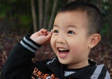 Cute Aisan Boy. Young boy playing cheerfully in the park Royalty Free Stock Photo