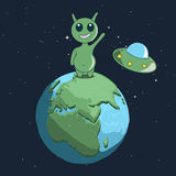 Cute alien stand on Earth and welcomes us Stock Photography
