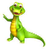 Cute Aligator cartoon character  pointing towards blank space Royalty Free Stock Images