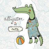 Cute alligator character with a ball Royalty Free Stock Image