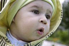 Cute amazed child. A cute amazed child looks away Stock Images