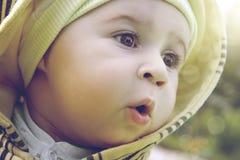 Cute amazed child. A cute amazed child looks away Royalty Free Stock Photo