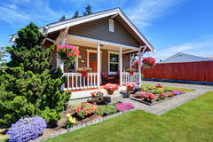 Cute American house exterior with covered porch and flower pots Stock Photo
