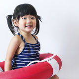 Cute And Innocent Asian Kid With Life Ring On White Backgroun