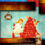 Cute angel with Christmas star indoors. Cheerful angel hanging a star on the Christmas tree indoors Stock Photos