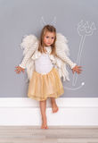 Cute angel devil  daughter Royalty Free Stock Images