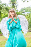 Cute angel girl on natural background Stock Photos