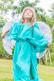 Cute angel girl on natural background Royalty Free Stock Photos