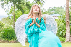 Cute angel girl on natural background Royalty Free Stock Images