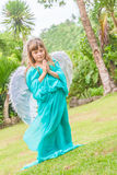 Cute angel girl on natural background Royalty Free Stock Photo