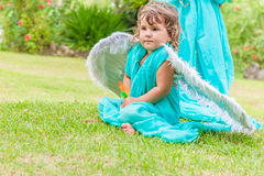 Cute angel girl on natural background. Cute angel girl on green natural background Royalty Free Stock Photography